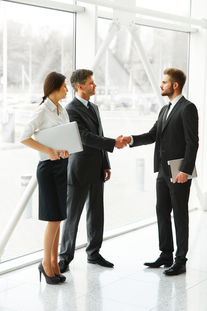 shaking hands: Business People. Successful Business Partner Shaking Hands in the office. Business Team