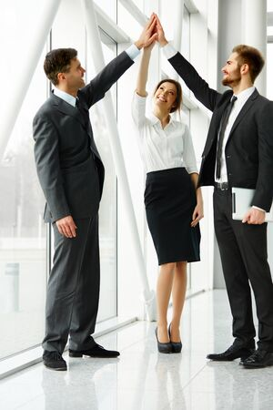 team hands: Business Team. Successful Business People Celebrating a Deal