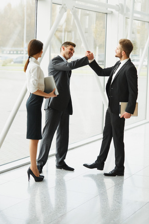 happy work: Business Team. Successful Business Partner Shaking Hands in the office. Business People