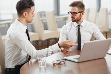 work team: Business People. Successful business partners discuss project. Team Work Stock Photo