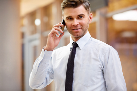 telephone call: Businessman Talking on the Phone Stock Photo