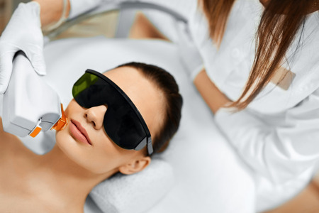 rejuvenation: Skin Care. Young Woman Receiving Facial Beauty Treatment, Removing Pigmentation At Cosmetic Clinic. Intense Pulsed Light Therapy. IPL. Rejuvenation, Photo Facial Therapy. Anti-aging Procedures. Stock Photo