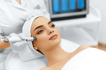 aesthetic: Face Skin Care. Close-up Of Woman Getting Facial Hydro Microdermabrasion Peeling Treatment At Cosmetic Beauty Spa Clinic. Hydra Vacuum Cleaner. Exfoliation, Rejuvenation And Hydratation. Cosmetology. Stock Photo