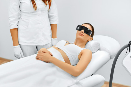 treatments: Body Care. Patien Before Underarm Laser Hair Removal. Removing Hair Of Young Womans Armpit. Laser Epilation Treatment In Cosmetic Beauty Clinic. Hairless Smooth And Soft Skin. Health And Beauty Concept. Stock Photo