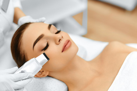 Skin Care. Close-up Of Beautiful Woman Receiving Ultrasound Cavitation Facial Peeling. Ultrasonic Skin Cleansing Procedure. Beauty Treatment. Cosmetology. Beauty Spa Salon. Reklamní fotografie