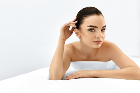 face: Beauty Face. Portrait Of Beautiful Smiling Model Woman Enjoying Her Perfect Fresh Clean Skin After Spa Treatment. Body And Skin Care, Cleansing And Moisturizing Concept. Healthy Lifestyle