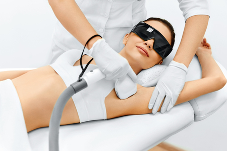 depilation: Body Care. Underarm Laser Hair Removal. Beautician Removing Hair Of Young Womans Armpit. Laser Epilation Treatment In Cosmetic Beauty Clinic. Hairless Smooth And Soft Skin. Health And Beauty Concept. Stock Photo