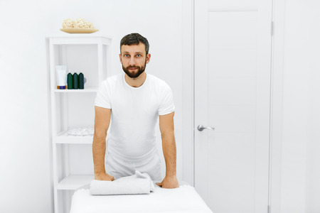 Body Care. Portrait Of Masseur Standing By Massage Table In Spa Salon. Physical Therapist In Medical Office. Beauty Treatment, Massage Therapy. Healthcare, Medicine Concept. Wellness, Lifestyle. Stock fotó - 49277429