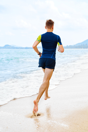 jogger: Fit Athlete Male Jogger Running On Beach.