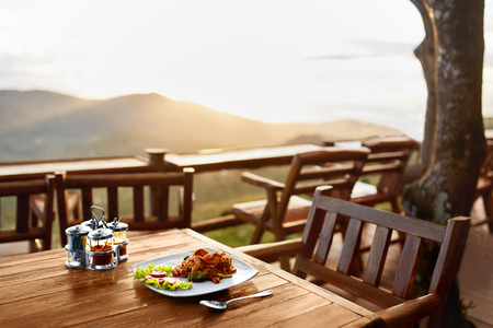 food dish: Food. Dinner In Thai Restaurant Outdoors. Healthy Organic Meal On Wooden Table. Beautiful Landscape, View, Hills On Background. Travel To Luxury Tropical Resort. Thailand Vacations. Lifestyle.