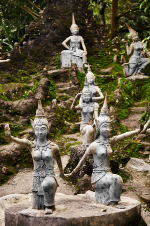 deities: Thailand. Closeup Of Magic Secret Buddha Garden Stone Statues In Koh Samui. Figures Of Human And Deities Dancing And Playing. Place For Relaxation And Meditation. Buddhism. Travel To Asia, Tourism. Stock Photo