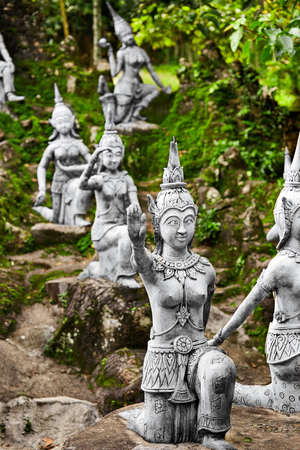 secret place: Thailand. Closeup Of Magic Secret Buddha Garden Stone Statues In Koh Samui. Figures Of Human And Deities Dancing And Playing. Place For Relaxation And Meditation. Buddhism. Travel To Asia, Tourism. Stock Photo