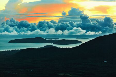 nature scenery: Nature Background. Scenic View Landscape Of Paradise Island During Sunset Or Sunrise Over The Sea With Beautiful Sky, Fluffy Cumulus Clouds. Beauty Scenery. Travel To Thailand. Tourism, Vacations.