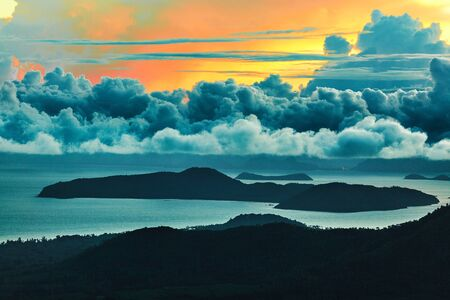 sea scenery: Nature Landscape. Scenic View Of Paradise Island During Sunset Or Sunrise Over The Sea With Beautiful Sky, Fluffy Cumulus Clouds. Beauty Scenery Background. Environment. Travel To Thailand. Tourism