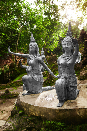 secret place: Thailand. Amphitheater Of Human And Deities Stone Statues In Buddha Magic Garden Or Secret Buddha Garden In Koh Samui Island. Place For Relaxation And Meditation. Buddhism. Travel To Asia, Tourism. Stock Photo