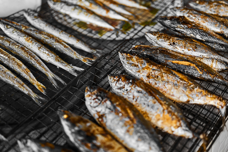 Healthy Food. Fish Cooking. Closeup Of Fresh Grilled Fried Mackerel Fish On Grill At Fish Market In Thailand, Asia. Thai Cuisine, Meal, Dish. Seafood Eating. Nutrition, Diet.