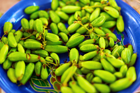 bilimbi: Healthy Fresh Raw Food. Close Up Of Organic Green Bilimbi ( Averrhoa Bilimbi , Tree Sorrel, Taling Pling Fruit, Belimbing ) In The Farmers Market In Thailand, Asia. Asian Fruits. Nutrition, Ingredient