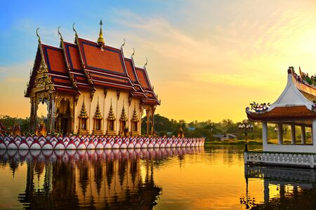 Thailand Landmark. Scenic View Of Buddhist Pagoda At Sunset. Temple Complex Wat Phra Yai Wat Plai Laem, Big Buddha Temple At Koh Samui. Travel, Tourism. Oriental Architecture. Landscape Background