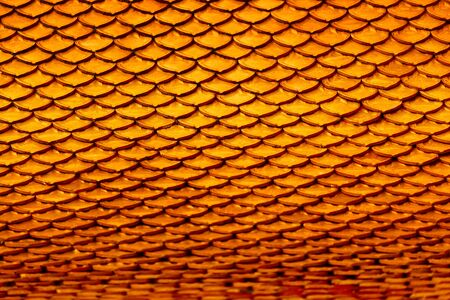buddhist temple roof: Texture Background. Orange Clay Tile Roof Texture Of Old Thai Temple. Details, Elements Of Buddhist Pagoda At Wat Phra Yai. Thailand Architecture, Ornaments And Decorations. Stock Photo
