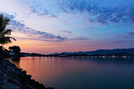 sea scenery: Nature Background. Scenic Night View Of Paradise Island Coast At Sunset Over Sea With Beautiful Sky. Scenery, Landscape. Tropical Seascape, Coastline. Travel On Vacations To Thailand. Tourism