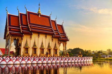 koh: Thailand Landmark. Scenic View Of Buddhist Pagoda At Sunset. Temple Complex Wat Phra Yai Wat Plai Laem, Big Buddha Temple At Koh Samui. Travel, Tourism. Oriental Architecture. Landscape Background