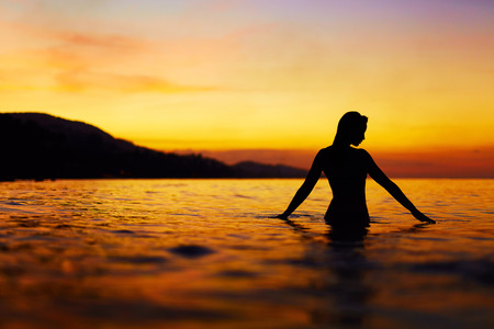 Healthy Lifestyle, Health Background. Silhouette Of Beautiful Young Woman Enjoying Sea Water And Sunset. Summer Travel Holidays Vacation. Happiness, Freedom, And Peace, Wellness, Body Care Concept. Stock Photo - 51806012