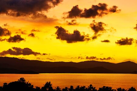 sea scenery: Nature Landscape. Scenic View Of Tropical Island Coast During Orange Sunset Over Sea With Beautiful Sky And Clouds. Scenery Background. Coastline. Travel On Summer Vacations To Thailand. Tourism