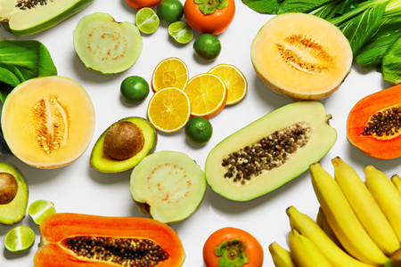 witaminy: Healthy Nutrition. Fresh Organic Vegetables And Fruits ( Bok Choy, Papaya, Salad, Persimmon, Avocado, Lime, Bananas , Melon, Guava, Oranges ). Food Ingredients Background. Vegetarian, Vitamins Concept