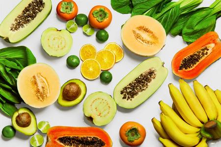 bok choy: Healthy Nutrition. Fresh Organic Vegetables And Fruits ( Bok Choy, Papaya, Salad, Persimmon, Avocado, Lime, Bananas , Melon, Guava, Oranges ). Food Ingredients Background. Vegetarian, Vitamins Concept
