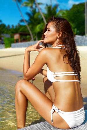 recreational sports: Woman Body Health. Healthy Lifestyle. Beautiful Happy Girl With Sexy Fit Body In Bikini On Surfing, Surf Board On Beach. Recreational Sports. Summer Relax, Holidays Travel Vacation. Beauty, Wellness
