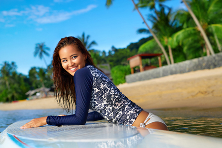 Sports. Active Lifestyle. Healthy Beautiful Happy Fit Young Asian Woman In Blue Wetsuit On Surfing, Surf Board In Sea Water. Summer Holidays Travel Vacation. Exotic Resort. Leisure Activity, Wellness