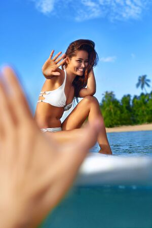 sexy asian woman: Summer Fun. Happy Young Surfer Woman With Sexy Fit Body In Fashion Bikini On Surfing, Surf Board In Sea Water Enjoying Travel Vacation In Tropical Resort. Sports, Healthy Lifestyle, Beauty, Wellness.