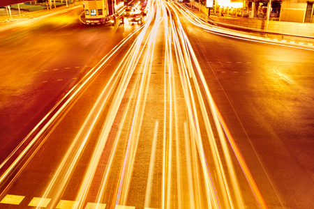 trails of lights: Transportation. Abstract Urban Background. Speed Traffic On Motorway ( Highway ) At Night, Light Trails On The Street In Bangkok, Thailand. Moving Car With Blur Lights On The Road Through Modern City. Stock Photo
