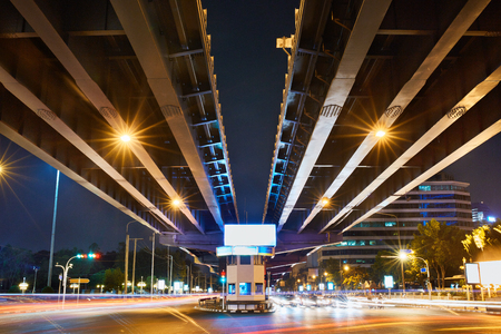trails of lights: Urban Street Landscape Background. Transportation In Bangkok City, Thailand. Speed Traffic Under Bridge At Night, Light Trails On Street. Blur Lights On Road. Night View.