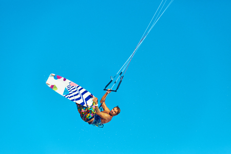 adrenaline: Kiteboarding, Kitesurfing. Water Sports. Professional Kite Surfer In Action In Air. Extreme Sport In Ocean. Healthy Active Lifestyle. Recreational Sporting Activity. Summer Fun, Hobby. Adrenaline.