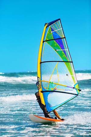 water sports: Recreational Water Sports. Windsurfing. Windsurfer Surfing The Wind On Waves In Ocean, Sea. Extreme Sport Action. Recreational Sporting Activity. Healthy Active Lifestyle. Summer Fun Adventure. Hobby