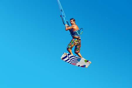 kiteboarding: Kiteboarding, Kitesurfing. Water Sports. Professional Kite Surfer In Action In Air. Extreme Sport In Ocean. Healthy Active Lifestyle. Recreational Sporting Activity. Summer Fun, Hobby. Adrenaline.