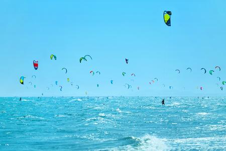 recreational sports: Kiteboarding, Kitesurfing. Water Sports. Scenic View Of Many Kitesurfers In Sea, Seascape On Background. Extreme Sport. Healthy Active Lifestyle. Recreational Sporting Activity. Summer Fun, Adventure