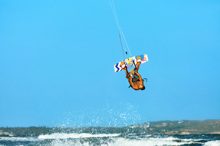 kiter: Extreme Water Sport. Kiteboarding, Kitesurfing Action. Professional Kiter Makes Difficult Trick In Air. Active Lifestyle. Hobby. Recreational Sporting Activity. Sports. Summer Fun, Adventure.