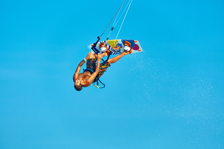 recreational sports: Extreme Water Sport. Kiteboarding, Kitesurfing Action. Professional Kiter Makes Difficult Trick In Air. Active Lifestyle. Hobby. Recreational Sporting Activity. Sports. Summer Fun, Adventure.
