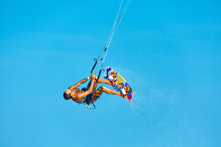 kiteboarding: Extreme Water Sport. Kiteboarding, Kitesurfing Action. Professional Kiter Makes Difficult Trick In Air. Active Lifestyle. Hobby. Recreational Sporting Activity. Sports. Summer Fun, Adventure.