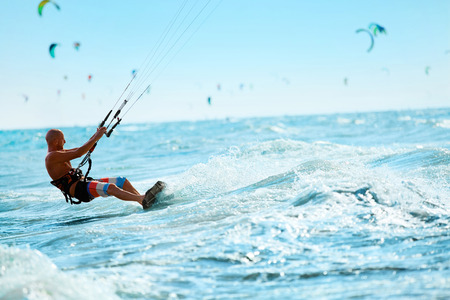 recreational sports: Kiteboarding, Kitesurfing. Water Sports. Professional Kite Surfer In Action On Waves In Ocean. Extreme Sport. Healthy Active Lifestyle. Hobby. Recreational Sporting Activity. Summer Fun, Adventure Stock Photo