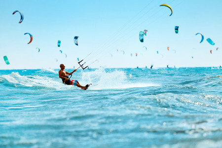 Kiteboarding, Kitesurfing. Water Sports. Professional Kite Surfer In Action On Waves In Ocean. Extreme Sport. Healthy Active Lifestyle. Hobby. Recreational Sporting Activity. Summer Fun, Adventure Foto de archivo