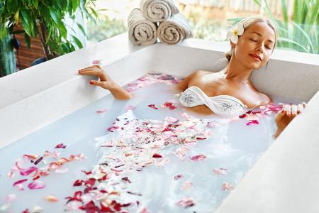 blonde bikini: Spa Relaxation. Woman Body Care. Beautiful Sexy Caucasian Blonde Girl In Bikini Lying In Flower Bath In Resort Day Spa Salon. Beauty Treatment, Skin Care Therapy. Wellness. Healthy Lifestyle Concept