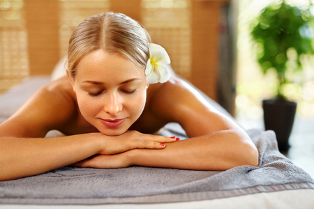 spa woman: Spa Woman. Beauty Treatment. Beautiful Healthy Caucasian Girl Relaxing On Massage Table Before  Procedure In The Spa Salon. Masseur Going To Massage Her Back. Body Care. Skin Care, Wellness, Wellbeing Stock Photo