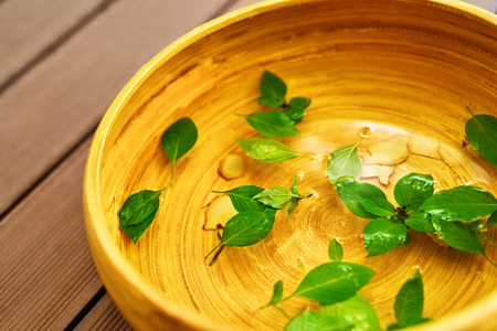 Spa Body Treatment. Foot Spa Basin, Bowl With Water, Natural Ingredients : Peppermint Leaves, Ginger, Essential Oils, For Detox Aromatherapy In Health Beauty Salon, Centre. Skin Care Pedicure Therapy