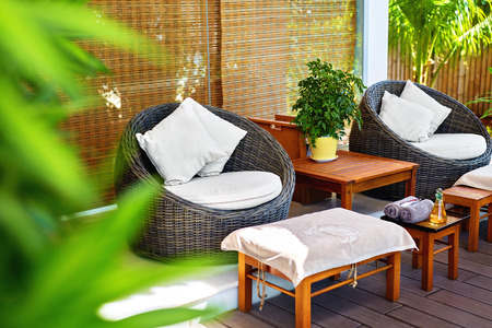 garden center: Spa Massage Salon. Image Of Rohtang Chairs And Stylish Furniture In Garden Terrace Of Luxury Health & Beauty Centre In Asia. Interior Design Stock Photo