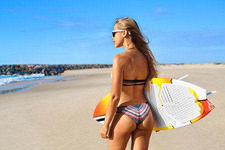 ass fun: Fitness Girl. Extreme Summer Water Sports. Surfing. Healthy Fit Woman With Perfect Sexy Body And Butt, Buttocks In Bikini Posing With Surfboard On Ocean Beach. Vacations, Lifestyle, Beauty, Health Stock Photo