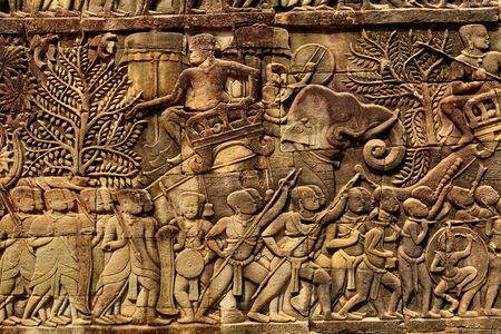 prasat bayon: Cambodia Architecture. Bas-relief , Wall Carving Of Prasat Bayon Temple In Angkor Thom, At Angkor Wat Complex. Scene Of Marching Army, Khmer Culture. Famous Landmark. Tourism. Ornament Background