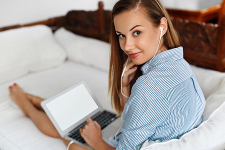 Business Woman Working On Laptop Computer On Couch At Home. Closeup Portrait Of Beautiful Happy Successful Smiling Female Freelancer Using PC. Freelance Work, People Communication Technology Concept
